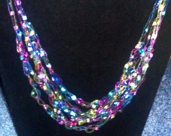 Micro Ribbon necklace in multi-color a full 7 strands in graduated layers.  Other colors available upon request.