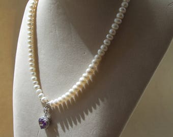 Ivory freshwater pearl, purple/white created topaz heart pendant necklace.
