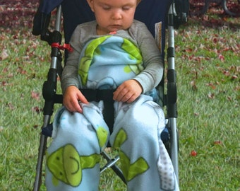 THE BLANKET WRAP         It's a blanket, It's a wrap!   A Unique Versatile Stroller and Car Seat Blanket