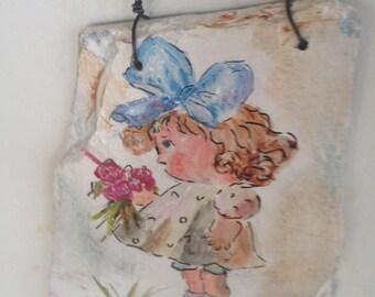 Painted slate girl holding flowers