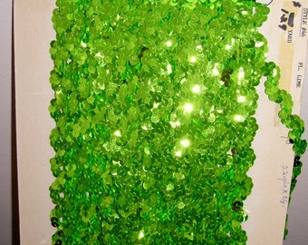 "Sequin Trim in Fluorescent Lime Green, Zig/Zag or Wave Pattern.  1/2"" x 5 yards.  Continuous, carded."