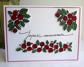 Hand stamped, coloured and die cut birthday card, with red roses, and Joyeux Anniversaire sentiment