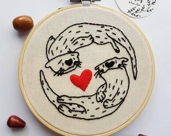 Embroidery love otters on embroidery hoop