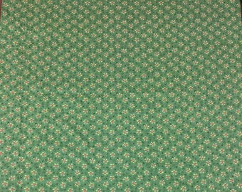 Green cotton fabric with small cranberries and white flowers