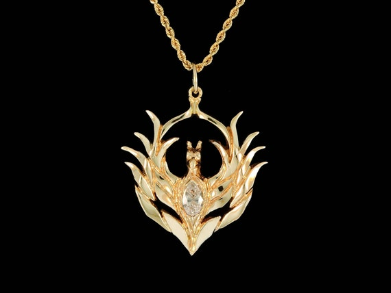 Small 14k yellow gold phoenix with marquise diamond accent aloadofball Images
