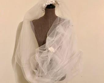 Vintage white cathedral length bridal veil.