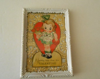 Framed  vintage mechanical Valentine kewpie look girl