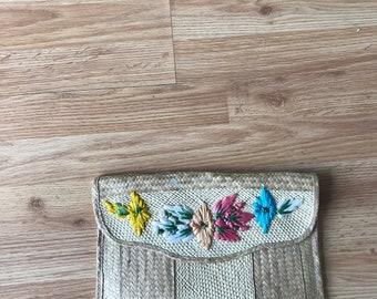 wicker rattan floral clutch