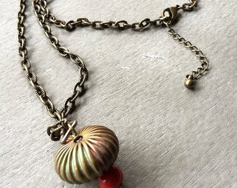 vintage brass orb and ceramic red bead on antiqued brass chain