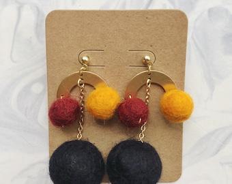 Wool pom pom earrings with raw brass charm