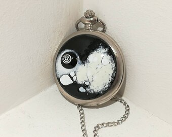 Watch Pocket in black and white enamels on copper.