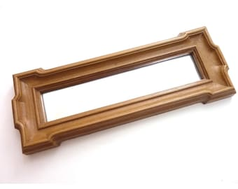 small vintage faux wood frame mirror