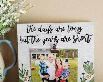 Hand painted wood sign/photo holder. The days are long but the years are short. Flowers. Mothers day gift. Birthday gift.