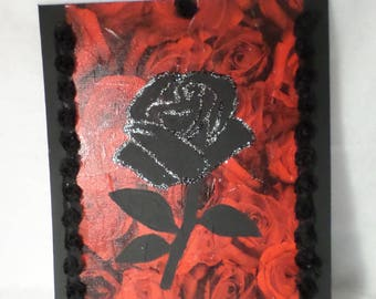Painting on canvas Board: black rose on a red rose background