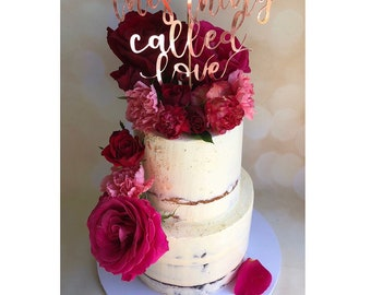 This thing called love cake topper