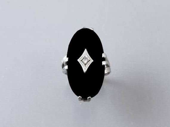 Massive asymmetrical 10k white gold black onyx and diamond statement kapow bypass style ring, size 7