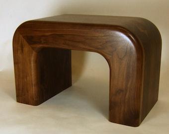 curved walnut bench