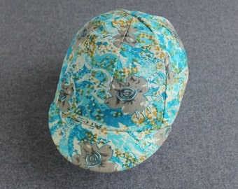 Blue floral cycling cap with torquoise lining