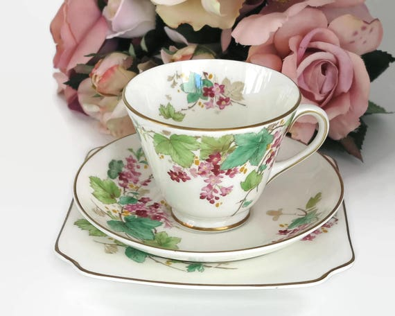 Royal Doulton trio, cup, saucer, and plate, Gillian pattern, pink flowered vines, gilt trim, England, circa 1950s