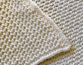 Textured cream baby blanket