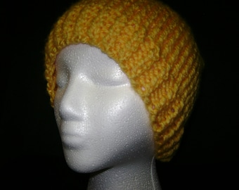 FREE SHIPPING   This is a warm hat that I have knitted with bulky 100% acrylic yarn. This is an adult sized hat.
