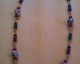Floral, fuschia, blue and green glass beads necklace.