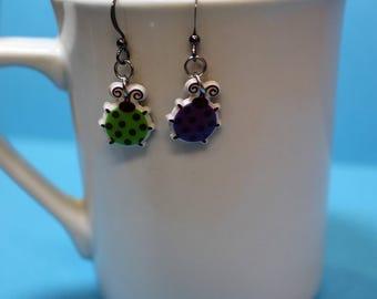 Mismatched ladybug earrings