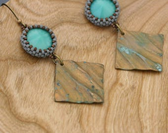 Turquoise rivolis beaded with glass beads and vintage patined brass earrings. Verdigris charms.