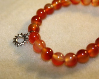 Orange Glass Beaded Stretch Bracelet with Sun Charm