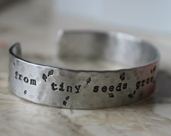 Mother's Day. Handstamped Cuff Bracelet. From tiny seeds grow mighty trees. Teacher Babysitter Mom Gift. Silver Aluminum or Copper.