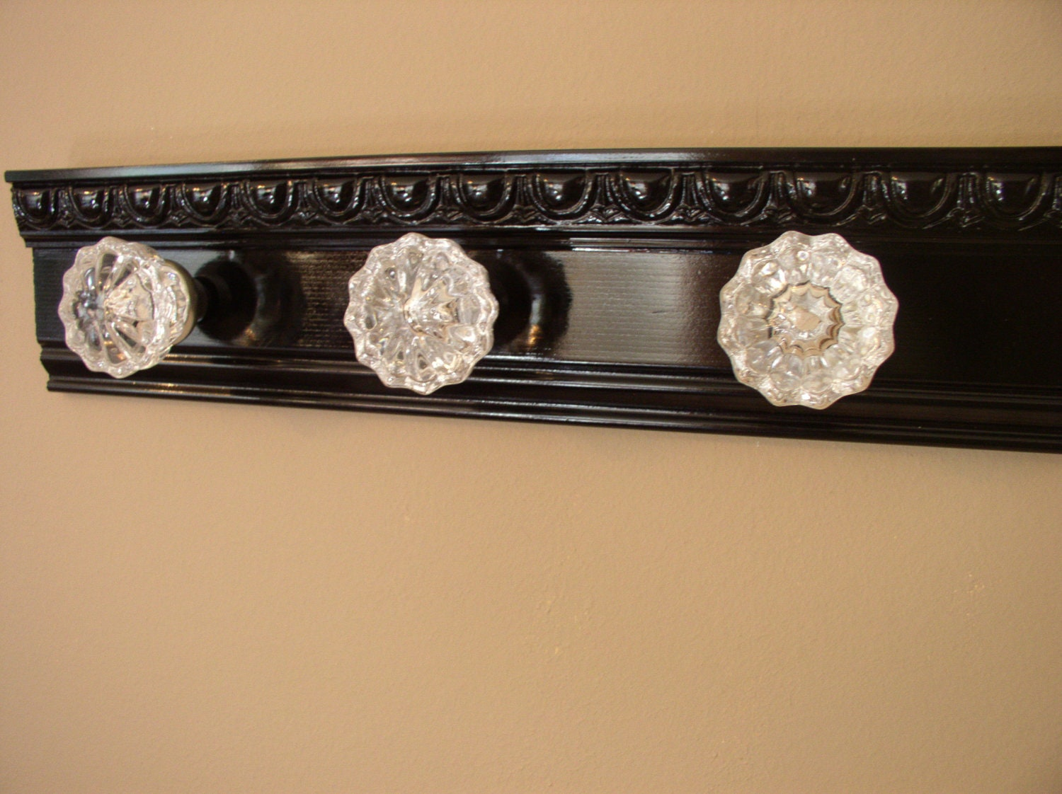 Beautiful coat rack with 3 glass door knobs and decorative