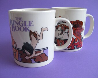 2 Vintage Kilncraft  Staffordshire mug with 2 different The Jungle Book Disney decors