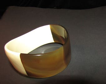 Vintage Plastic Cuff Bracelet. Chic Ivory and deep tortoise shell cuff in clean geometric design. Edges of cuff undulate in a wave.