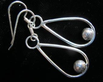 pair of sterling hoop earrings with solid sterling ball