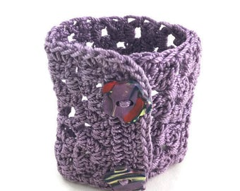 Violet crochet cuff with flower buttons