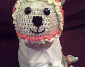 Crochet baby lion hat, bootees, and mittens.