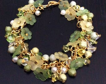 Lucite Flowers and pearls bracelet, green hues and gold-coloured metal