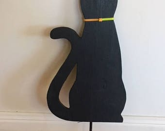 Handmade garden cat stake with reflective eyes