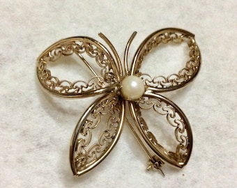 Butterfly brooch genuine pearl center gold filigree.