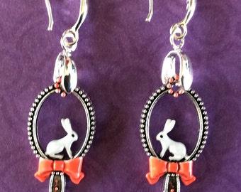 White rabbit earrings. Alice in wonderland earrings. Easter earrings. Bunny earring. Steampunk earring. Bow earrings. Hand Painted earrings.