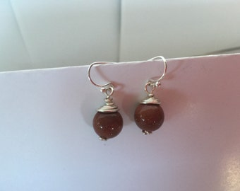 Wire wrapped bead earring brown rust color with shimmer. Nickle free silver plated wire.