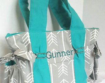Turquoise diaper bag, large arrow diaper bag, grey arrows with turquoise straps and lining. Key pocket, option of removable strap and zipper