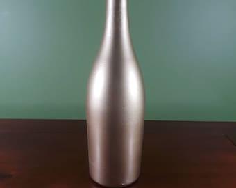 Metallic Gold Wine Bottle Centerpiece