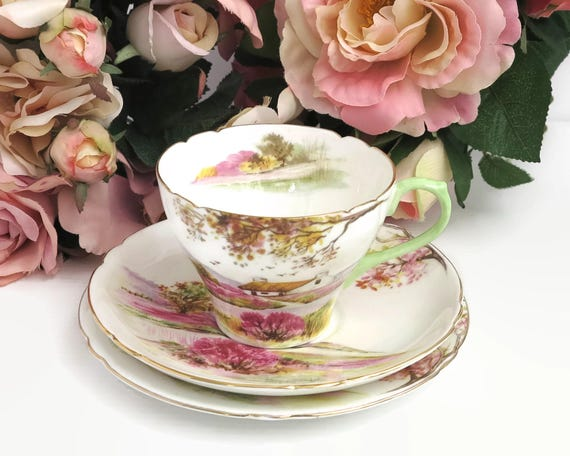 Vintage Shelley Old Ireland tea cup, saucer, and plate, hand painted scene of Irish countryside with pink and gilt trim, 13657, 1945 - 1966