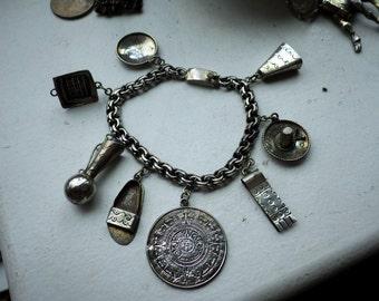 CASTELAN Vintage Mexican Sterling Silver Large Charm Bracelet - 8 charms.