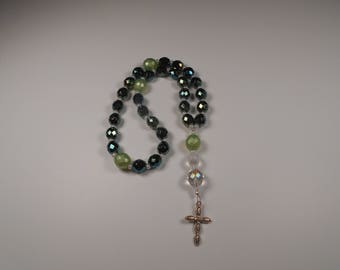 Lime green with dark blue beads.  Cross is silver.