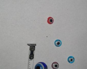 rare glass  eye miniture beads plus larger eye ball in glass