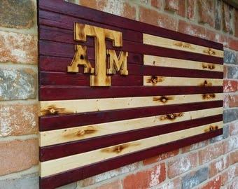 Texas A&M, burnt wood flag