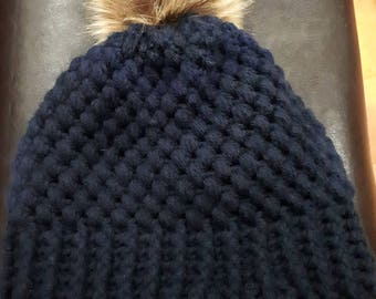 Beautiful hand crocheted hat with faux fur pom pom!