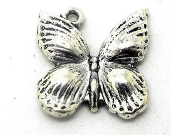 Butterfly domed silver colored metal charm